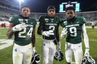 EAST LANSING, MI - NOVEMBER 30: Michigan State running backs Elijah Collins (24), Anthony Williams Jr. (9) and wide receiver Julian Barnett (2) pose for a picture following a college football game between the Michigan State Spartans and Maryland Terrapins on November 30, 2019 at Spartan Stadium in East Lansing, MI. (Photo by Adam Ruff/Icon Sportswire)