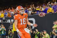 NEW ORLEANS, LA - JANUARY 13: Clemson Tigers quarterback Trevor Lawrence (16) scores a first half rushing touchdown during the CFP National Championship game between the LSU Tigers and Clemson Tigers at the Mercedes-Benz Superdome on January 13, 2020 in New Orleans, LA. (Photo by Ken Murray/Icon Sportswire)
