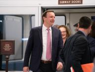 Sen. Chris Murphy (D-Conn.) heads for the Senate Chamber prior to the first day of opening arguments by the president