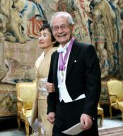 Japanese scientist Akira Yoshino, one of three winners of the 2019 Nobel Prize in chemistry, walks with his wife Kumiko to a banquet hosted by Swedish King Carl XVI Gustaf at the royal palace in Stockholm on Dec. 11, 2019. (Pool photo) (Kyodo) ==Kyodo