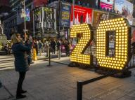 "New York,NY/USA-December 12, 2019 Visitors to Times Square in New York pose in front of the two seven-foot-tall numerals â2â and â0â in Times Square in New York on Wednesday, December 12, 2019 . The â20â will be part of the led display atop One Times Square which will light up at midnight January 1 spelling out ""2020â ushering the New Year. The seven-foot tall numbers use energy efficient LED bulbs which will last the entire year, never having to be changed. (Â Richard B. Levine)"
