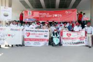 MULTAN, PAKISTAN, SEP 29: Participants pass through a road during awareness walk organized by Cardiology Institute and Nishtar Medical University and Hospital on the occasion of World Heart Day held in Multan on Tuesday, September 29, 2020. (Abdul Sattar\/PPI Images