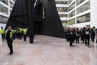 UNITED STATES - JANUARY 17: Capitol police watch the group Remove Trump as it participates in a âSwam the Senateâ protest in the atrium of the Hart Senate Office Building calling for the removal of President Donald Trump on Friday, Jan. 17, 2020. (Photo by Caroline Brehman/CQ Roll Call)