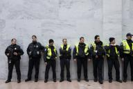 UNITED STATES - JANUARY 17: Capitol Police line the wall as the group Remove Trump participates in a âSwam the Senateâ protest in the atrium of the Hart Senate Office Building calling for the removal of President Donald Trump on Friday, Jan. 17, 2020. (Photo by Caroline Brehman/CQ Roll Call)