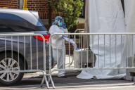 A refrigerated try with a frigurific truck is used as a morgue at The Brooklyn Hospital Center in the Brooklyn neighborhood of New York during the Coronavirus COVID-19 pandemic in the United States. Pictured: Ref: SPL5160151 010420 NON-...