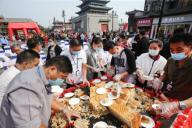 Thousands gathered in central China\'s Kaifeng City to sample a massive mooncake as the Mid-Autumn Festival approaches, which weighs 190 kilograms and 1.1 metres in diameter, Kaifeng City, central China\'s Henan Province, 1st October 2020. The