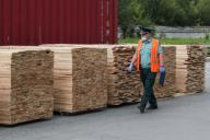 YEKATERINBURG, RUSSIA - JULY 9, 2020: A customs officer inspects lumber at the Verkh-Isetsky Station of the Yekaterinburg Customs. Donat Sorokin\/TASS