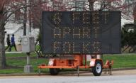 A large highway sign reminds people to keep their distance of six feet from each other, stragetically placed in downtown St. Louis on Monday, March 30, 2020. Photo by Bill Greenblatt/