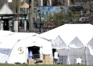 A playground is empty near a field hospital that is set up to take sick patients in Central Park in New York City on Wednesday, April 1, 2020. The tents are located along the East Meadow near Mt. Sinai Hospital and are being used as an overflow medical center. They were erected in 48 hours by the non-profit charity Samaritan