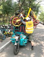 A worker loads rent-a-bikes, due for service, onto a vehicle as the demand for bicycles have increased due to the pandemic in Beijing on Thursday, July 16, 2020. China reported just one new confirmed case of the Covid-19 in the past 24 hours and two asymptomatic cases, as the U.S. struggles to fight the rising infections and deaths across the country. Photo by Stephen Shaver