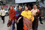 (191212) -- DHAKA, Dec. 12, 2019 (Xinhua) -- Relatives of plastics factory fire victims are seen at Dhaka Medical College Hospital in Dhaka, capital of Bangladesh, Dec. 12, 2019. At least 13 people have died in a devastating fire at a plastics factory in Keraniganj on the outskirts of Bangladesh