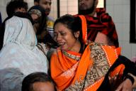 (191212) -- DHAKA, Dec. 12, 2019 (Xinhua) -- Relatives of plastics factory fire victims wail at Dhaka Medical College Hospital in Dhaka, capital of Bangladesh, Dec. 12, 2019. At least 13 people have died in a devastating fire at a plastics factory in Keraniganj on the outskirts of Bangladesh