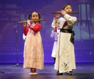 (200126) -- HOUSTON, Jan. 26, 2020 (Xinhua) -- Students from a local art group perform during Chinese Lunar New Year celebrations in Houston, the United States, on Jan. 25, 2020. The Asia Society Texas Center in Houston held Chinese Lunar New Year celebrations Saturday. Local Americans and Chinese participated in the event. (Photo by Lao Chengyue/Xinhua)