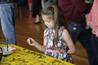 (200126) -- HOUSTON, Jan. 26, 2020 (Xinhua) -- A child tries Chinese calligraphy during Chinese Lunar New Year celebrations in Houston, the United States, on Jan. 25, 2020. The Asia Society Texas Center in Houston held Chinese Lunar New Year celebrations Saturday. Local Americans and Chinese participated in the event. (Photo by Lao Chengyue/Xinhua)