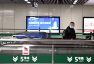 (200126) -- ZHENGZHOU, Jan. 26, 2020 (Xinhua) -- A passenger wearing a mask is seen at a station in the subway line 5 in Zhengzhou, central China