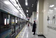 (200126) -- ZHENGZHOU, Jan. 26, 2020 (Xinhua) -- A staff member wearing a mask is seen at a station in teh subway line 5 in Zhengzhou, central China