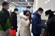 (200126) -- ZHENGZHOU, Jan. 26, 2020 (Xinhua) -- Passengers line up to have body temperatures measured at a station in the subway line 5 in Zhengzhou, central China
