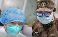 (200126) -- WUHAN, Jan. 26, 2020 (Xinhua) -- A member of a military medical team takes over the work from a medical worker at Wuhan Jinyintan Hospital in Wuhan, central China