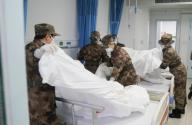 (200126) -- WUHAN, Jan. 26, 2020 (Xinhua) -- Members of a military medical team prepare a ward at Wuhan Jinyintan Hospital in Wuhan, central China