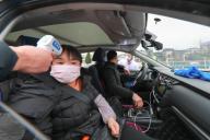(200126) -- TONGREN, Jan. 26, 2020 (Xinhua) -- A staff checks a passenger
