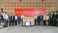 (200331) -- VIENTIANE, March 31, 2020 (Xinhua) -- Economic and commercial counselor of Chinese embassy in Laos Wang Qihui (central L) and Lao Deputy Health Minister Bounfeng Phoummalaysith (central R) pose for photos after the handover ceremony of supplies donated by China for Laos in Vientiane, Laos, March 30, 2020. Medical equipment provided by China to help Laos fight the COVID-19 pandemic were handed over in the Lao capital Vientiane on Monday. The materials include 2,016 testing kits, 5,000 sets of protective clothing and 405,000 face masks, according to the Chinese embassy in Laos. (Photo by Kaikeo Saiyasane/Xinhua)