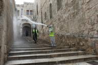 (200331) -- JERUSALEM, March 31, 2020 (Xinhua) -- Workers clean an alley in Jerusalem