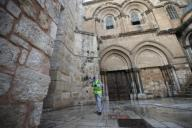 (200331) -- JERUSALEM, March 31, 2020 (Xinhua) -- A worker cleans the plaza outside the Church of the Holy Sepulchre in Jerusalem