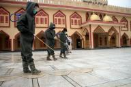 (200331) -- MEHTARLAM, March 31, 2020 (Xinhua) -- Workers disinfect a mosque in Mehtarlam, capital of east Afghanistan