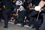 """(200531) -- NEW YORK, May 31, 2020 (Xinhua) -- Officers of New York police department arrest a demonstrator during a protest over the death of George Floyd in the Brooklyn borough of New York, the United States, May 30, 2020. New York officials on Saturday denounced acts of violence in the city\'s protests over George Floyd\'s death, after about 300 protesters were arrested in days. Mayor Bill de Blasio said at a briefing that some protesters """"came with an agenda of violence and incitement,"""" and the city does not allow it to happen. (Photo by Michael Nagle\/Xinhua)"""