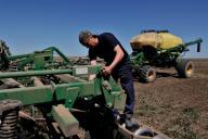 (200531) -- NUR-SULTAN, May 31, 2020 (Xinhua) -- Photo taken on May 30, 2020 shows a farmer checking trucks in a farm in Akmol village, Akmola Region, Kazakhstan. (Photo by Kalizhan Ospanov\/Xinhua)
