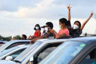 """(200531) -- COLOMBO, May 31, 2020 (Xinhua) -- People attend a drive-in open-air musical show at Ratmalana Airport, a domestic airport in Colombo, Sri Lanka, May 30, 2020. The first experimental Drive-in Concert after the COVID-19 outbreak, which is part of the """"Restart Sri Lanka"""" initiative, was held in Ratmalana Airport premises on Saturday. (Photo by A.hapuarachchi\/Xinhua)"""