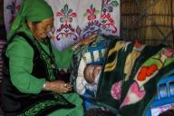 (200713) -- ILI, July 13, 2020 (Xinhua) -- A woman looks after her grandchild in a yurt at the summer meadow in Tekes County, northwest China\'s Xinjiang Uygur Autonomous Region, June 30, 2020. (Xinhua\/Wang Fei