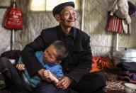 (200713) -- ILI, July 13, 2020 (Xinhua) -- A man has fun with his grandchild in a tent at the summer meadow in Tekes County, northwest China\'s Xinjiang Uygur Autonomous Region, July 1, 2020. (Xinhua\/Wang Fei