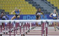 (200926) -- DOHA, Sept. 26, 2020 (Xinhua) -- Payton Chadwick (2nd L) of the United States competes during the women\'s 100m hurdles final at the 2020 Diamond League Athletics Meeting in Doha, Qatar, Sept. 25, 2020. (Photo by Nikku\/Xinhua