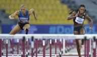(200926) -- DOHA, Sept. 26, 2020 (Xinhua) -- Payton Chadwick (L) of the United States competes during the women\'s 100m hurdles final at the 2020 Diamond League Athletics Meeting in Doha, Qatar, Sept. 25, 2020. (Photo by Nikku\/Xinhua