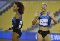 (200926) -- DOHA, Sept. 26, 2020 (Xinhua) -- Payton Chadwick (R) of the United States celebrates after the women\'s 100m hurdles final at the 2020 Diamond League Athletics Meeting in Doha, Qatar, Sept. 25, 2020. (Photo by Nikku\/Xinhua