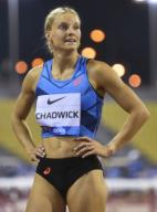 (200926) -- DOHA, Sept. 26, 2020 (Xinhua) -- Payton Chadwick of the United States reacts after the women\'s 100m hurdles final at the 2020 Diamond League Athletics Meeting in Doha, Qatar, Sept. 25, 2020. (Photo by Nikku\/Xinhua