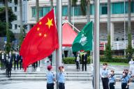 (201001) -- MACAO, Oct. 1, 2020 (Xinhua) -- A flag-raising ceremony is held to celebrate the 71st anniversary of the founding of the People\'s Republic of China at the Golden Lotus Square in Macao, south China, Oct. 1, 2020. (Xinhua\/Cheong Kam Ka
