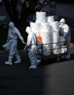 New coronavirus Medical workers in protective gear carry a cart loaded with containers for medical waste as they begin a shift for the service of people infected with the new coronavirus at a hospital in the southeastern city of Daegu, the epicenter of South Korea