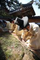 Chuseok ceremony for ancestors amid pandemic Members of the Byun family perform a traditional ceremony in honor of their ancestors at an old traditional mansion in Andong, North Gyeongsang Province, on the Chuseok autumn harvest holiday on Oct. 1, 2020, wearing protective masks and standing apart from one another amid the COVID-19 pandemic. (Yonhap)\/2020-10-01 16:26:31\/ < 1980-2020 YONHAPNEWS AGENCY.